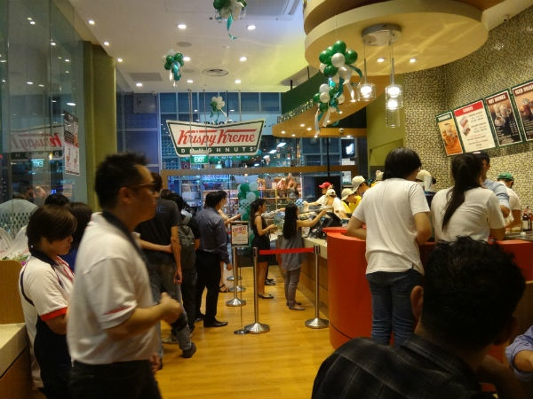 Barely seconds after opening, there are already plenty of people inside Krispy Kreme's second Singapore store.