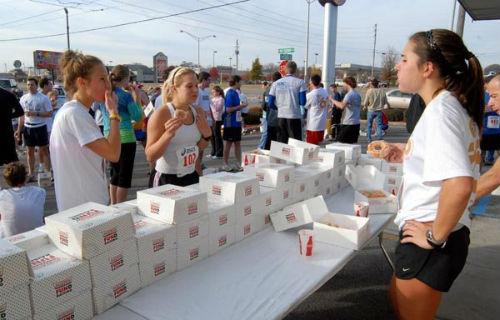 Gorge yourself on donuts at the Krispy Kreme challenge. (Image from marathontalk.com)