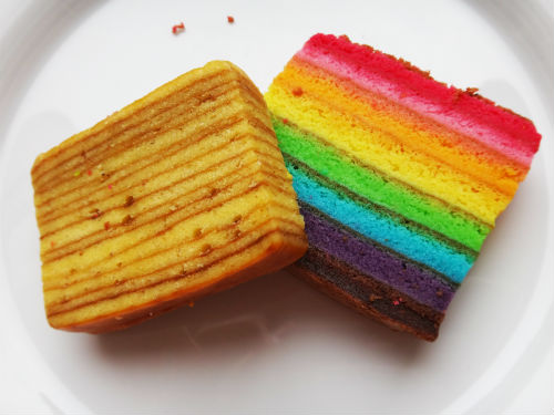 Traditional and Rainbow kueh lapis layered cakes.