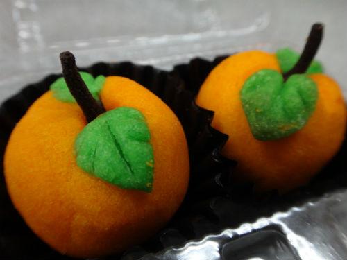 Pineapple tarts made to look like mandarin oranges.