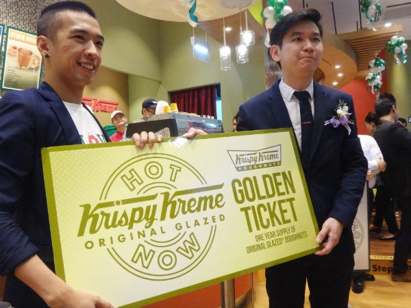 Mark Lin (Left), the winner of the Krispy Kreme Golden Ticket.