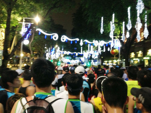 Marathoners get ready to start running at the starting pen along Orchard Road.