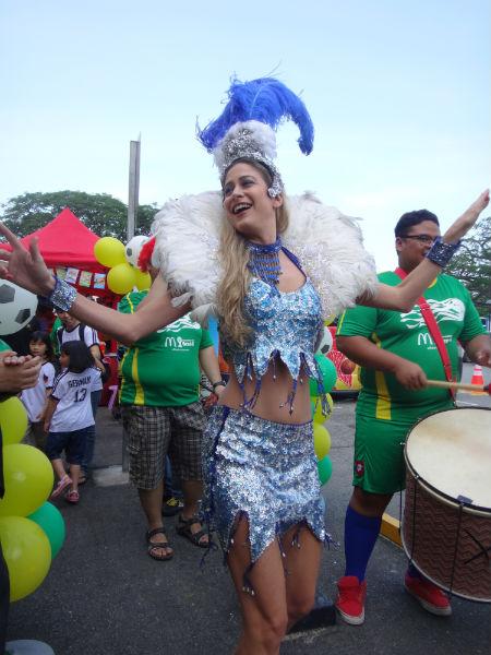 Samba dancing to the beat.