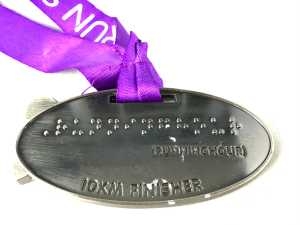 Runninghour 2015's unique medal comprises of Braille text.