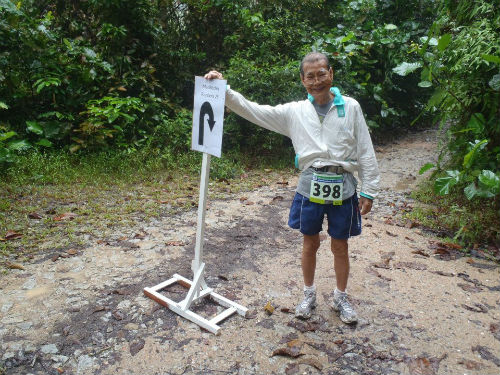 Proudly posing at the U-Turn point at the MR25 Ultra Marathon '13. (Reproduced with permission from Chan Meng Hui)