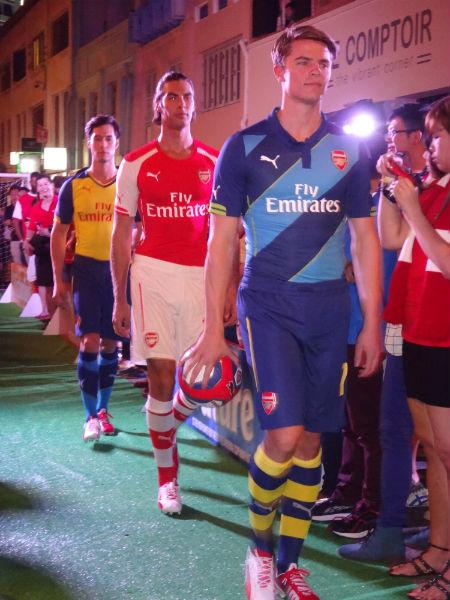 Model showcasing Arsenal's new kits.