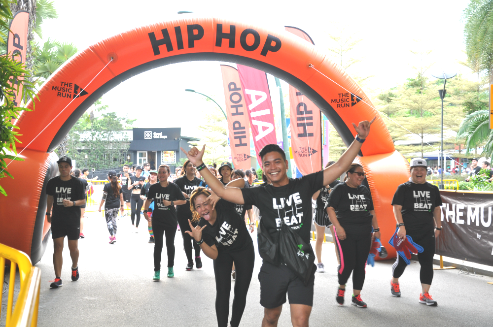 Happy runners heading through the Hip Hop Zone.