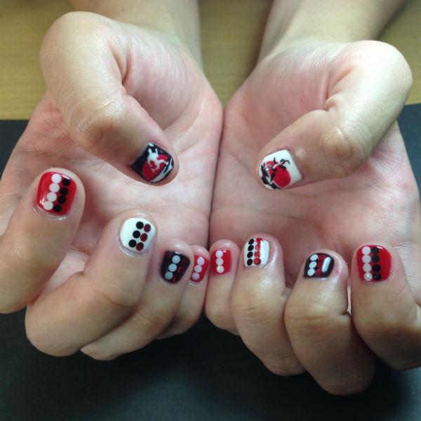My beautiful Sundown Marathon themed nails, designed by Ann Lim.