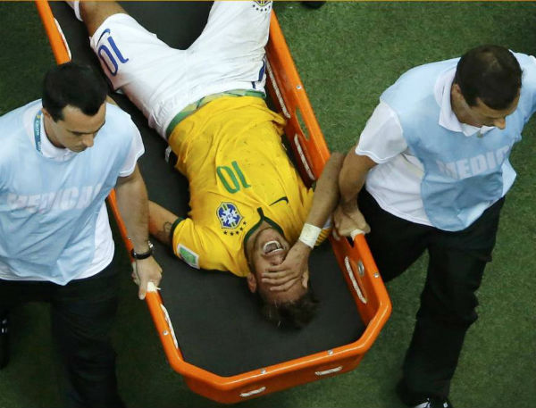 Neymar's pain and anguish can be seen clearly in his face. Can the Selecao march on without him? (Image: Japan Times)