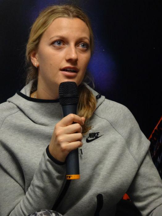 Kvitova tends to students' queries.
