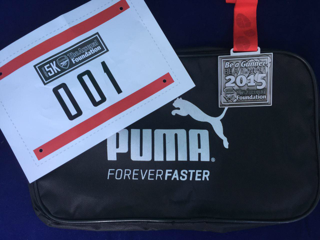 I won a Puma shoe bag in the lucky draw. In this photo is the shoe bag together with my race bib and the 2015 finisher medal.