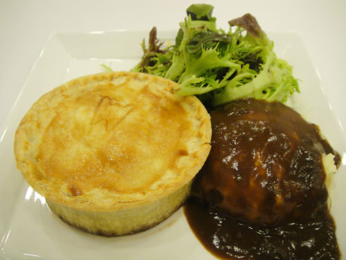 The pies are served with mashed potato and salad.