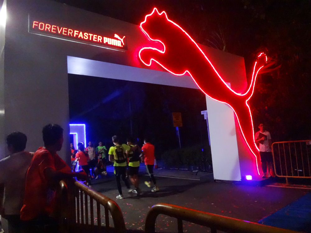 The finishing line is lit up with neon lights.
