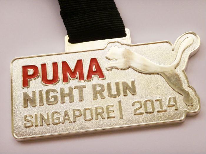 Puma Night Run race medal.
