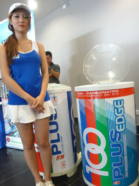 You can get cool and refreshing 100 Plus drinks at the Sports Hub. (But sorry folks, not the girl though).