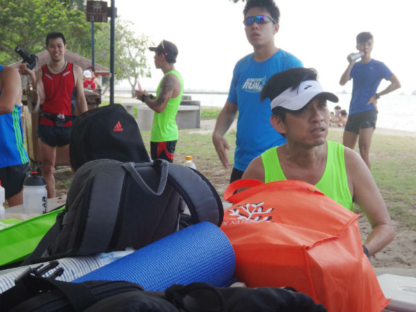 Runners are relaxing after their efforts.