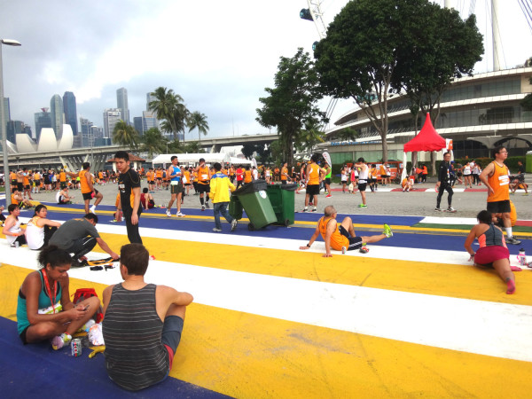 Runners relax at the F1 Pit Building after the race.