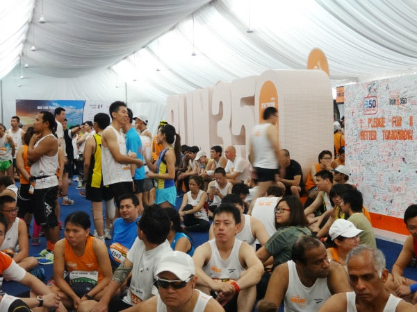 The 21km runners camping in the tent, hoping for the rain to stop.