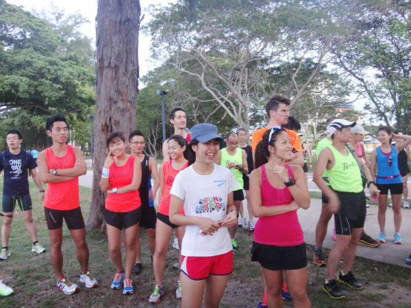 Runners are listening intently to what Mok has to say.