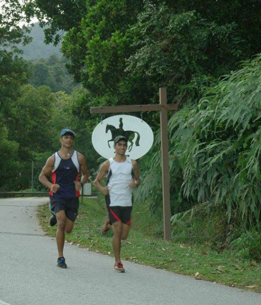 Nabin and his friend, Ajmil, running in the hills of Malaysia, whilst on holiday.