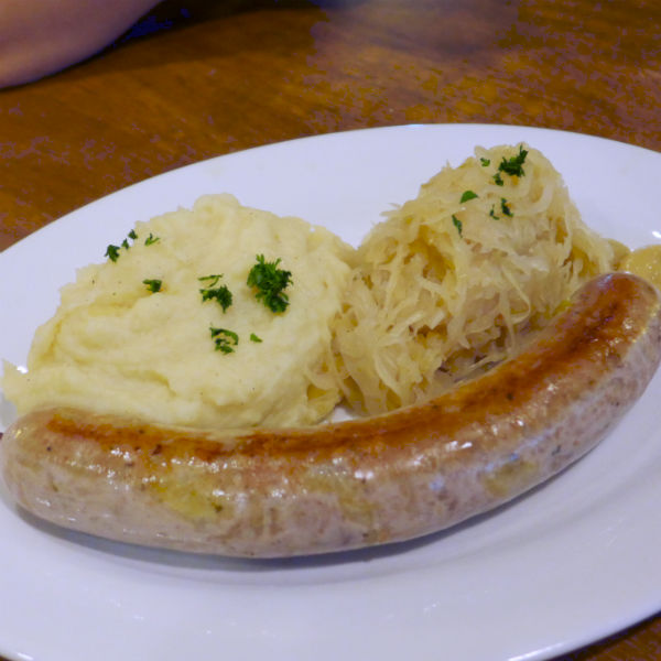 Cheese sausage, served with mashed potatoes & sauerkraut.