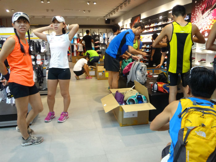 Runners put their stuff away at the Adidas store, before embarking on the run.
