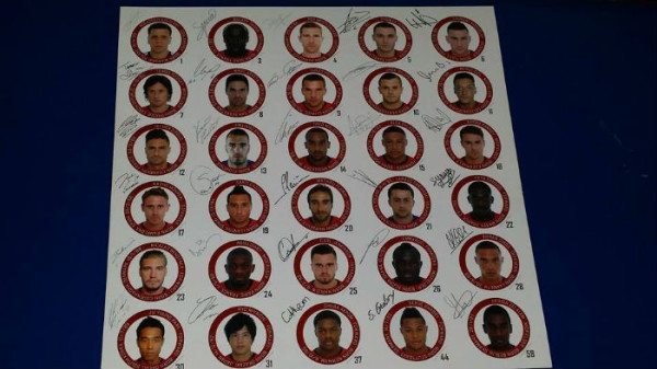 Autographs of the whole team, another gift from Arsenal to Jason.
