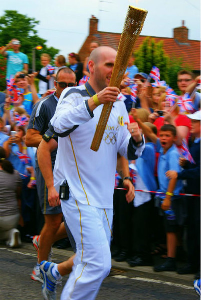 Simon as a torchbearer for the London Olympic Games last year.