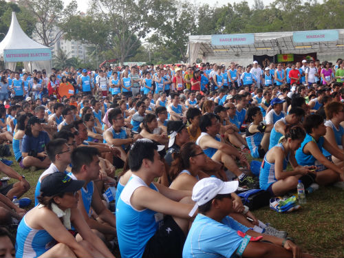 Runners watching with bated breath to see who would win the MediaCorp Hong Bao Run.