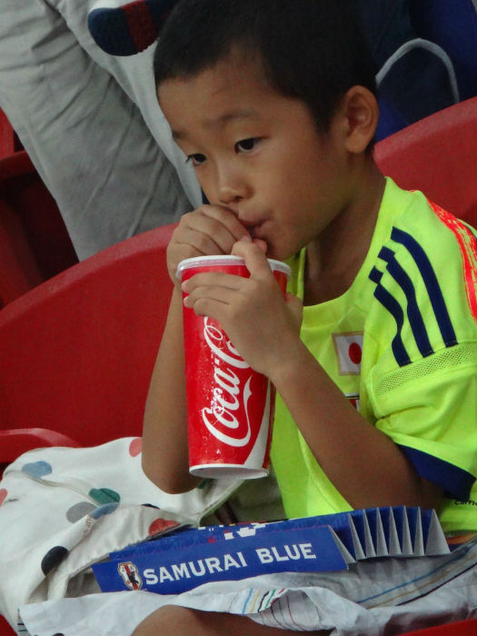 A young Japanese fan has no clue at what is in store for him.