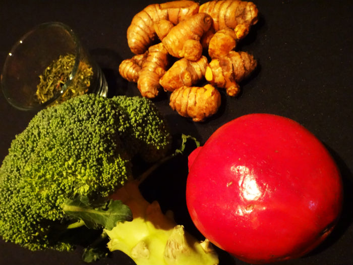 The four superfoods - broccoli, turmeric, pomegranate and green tea.