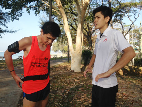 Steady and Kheng Hong are taking a break during the morning's run.