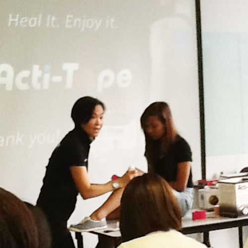 A taping demonstration on a girl's knee.