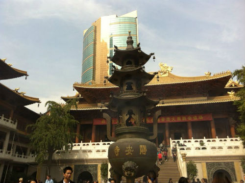 The paradox of Shanghai - historic temples against skyscrapers. (Picture courtesy of Jia Zhen).