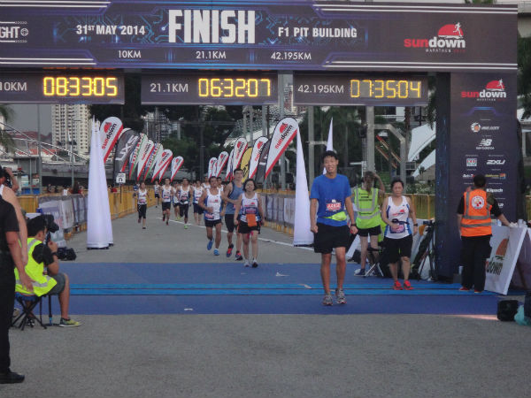 Runners crossing the finishing line.