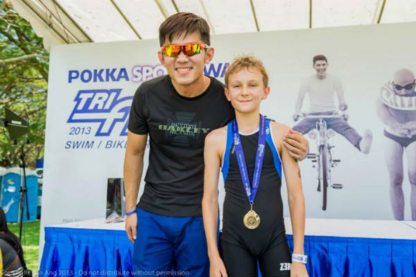 Jackson posing with his medal. (Photo from Tri Factor Series Run Singapore)
