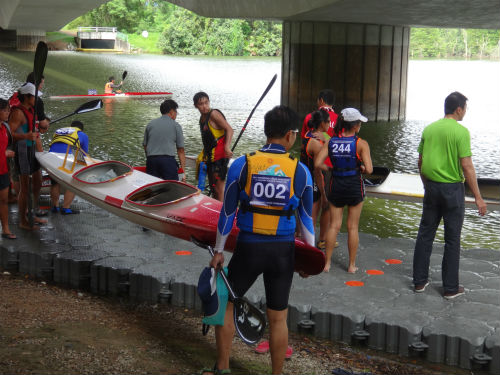 Getting ready to push their canoe into the water during a tryout session.