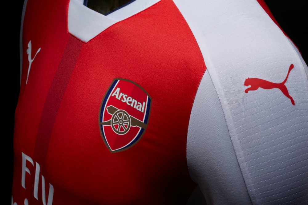 The Puma Cat logo on the shirt sleeve.