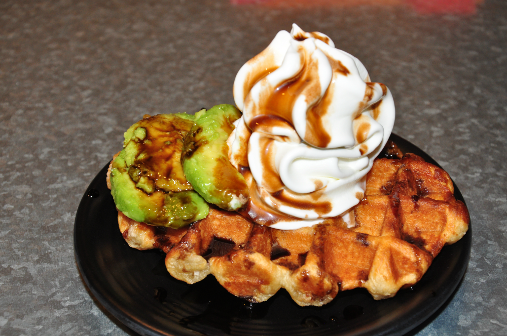 Belgium Waffle with avocado and Gula Melaka syrup.