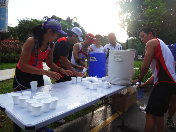 Helpers are getting the water station all ready for thirsty runners.