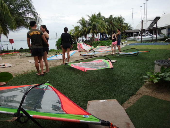 Walking to the Windsurfing simulators on land, at ConstantWind Sea Sports school in Changi.
